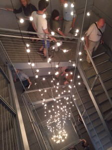 A light installation by Felix Gonzales Torres activates the stairwell.